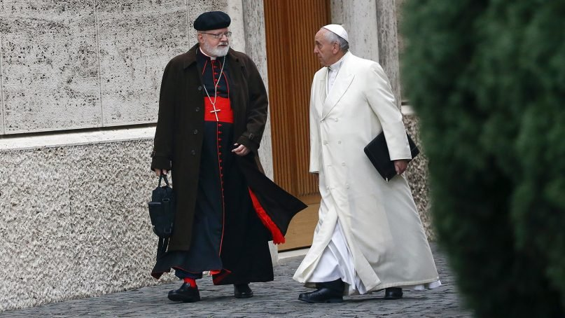 Pope Francis talks with Cardinal Sean Patrick O'Malley, left as they arrive for a consistory at the Vatican on Feb. 13, 2015. Photo courtesy of Reuters/Tony Gentile