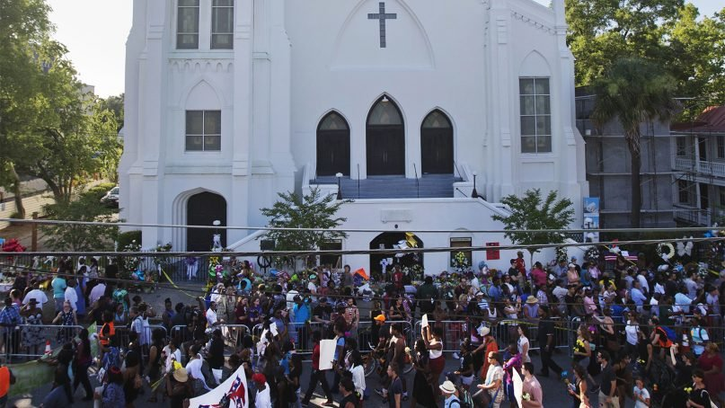 People march in memory of the Mother Emanuel AME Church shooting victims in Charleston, S.C., on June 20, 2015. (AP Photo/David Goldman)