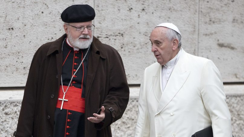 Pope Francis, right, talks with the head of a sex abuse advisory commission, Cardinal Sean Patrick O'Malley, of Boston, as they arrive for a special consistory in the Synod hall at the Vatican on Feb. 13, 2015. (AP Photo/Andrew Medichini)