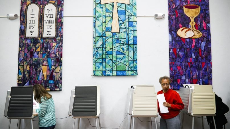 Voters fill out ballots at a polling place inside the Pleasant Ridge Presbyterian Church on Election Day, Nov. 8, 2016, in Cincinnati. (AP Photo/John Minchillo)