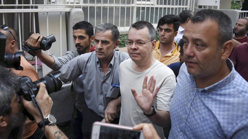 Andrew Brunson, an evangelical pastor from Black Mountain, North Carolina, center, waves as he leaves a prison outside Izmir, Turkey, on July 25, 2018, to go to house arrest. (DHA via AP)