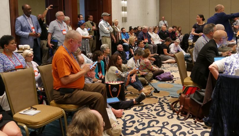 Deputies, bishops and visitors pack a meeting room in the Austin Hilton Hotel on July 5, 2018, to testify on three marriage-related resolutions during the Episcopal triennial General Convention. Photo by Mary Frances Schjonberg/Episcopal News Service