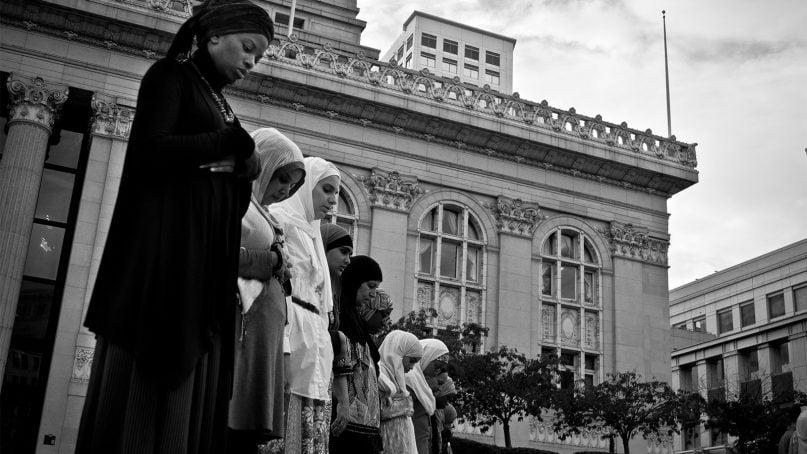 Muslim women offer prayers in 2011.  Photo by Glenn Halog/Creative Commons