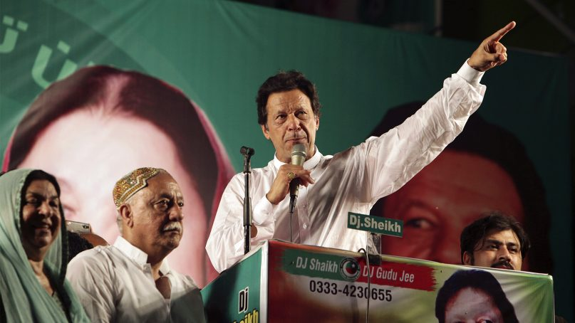 Pakistani politician Imran Khan, chief of Pakistan Tehreek-e-Insaf party, addresses his supporters during an election campaign in Lahore, Pakistan, on July 23, 2018. Pakistan holds general elections on July 25. (AP Photo/K.M. Chaudary)