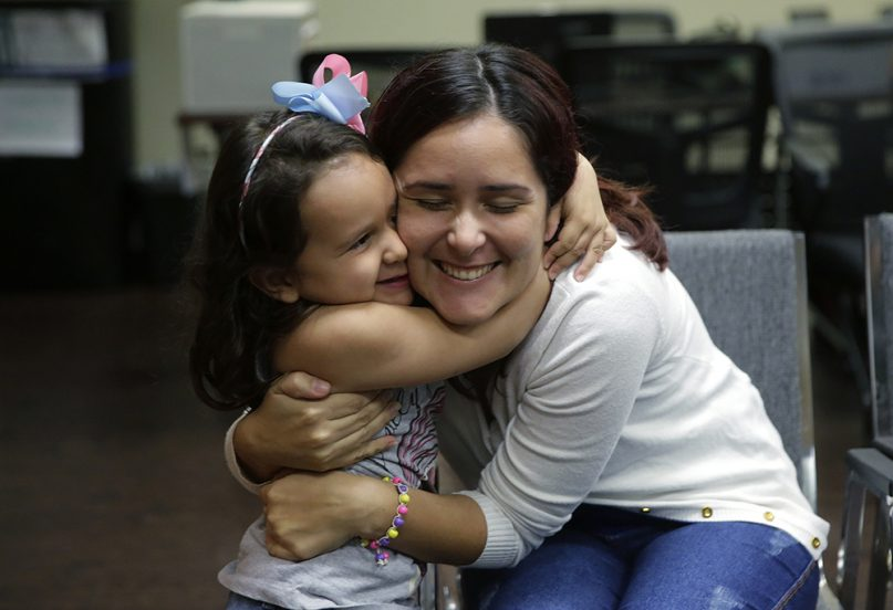 Immigrants seeking asylum Natalia Oliveira da Silva and her daughter, Sara, 5, hug as they wait at a Catholic Charities facility in San Antonio on July 23, 2018. Since their separation in late May, the daughter had been at a shelter for immigrant minors in Chicago, while Oliveira was taken to various facilities across Texas. As the government faces a fast-approaching deadline to reunite hundreds of families, it is shifting the responsibility for their well-being to faith-based groups primarily in Texas and Arizona. (AP Photo/Eric Gay)