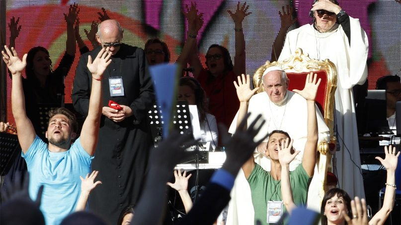 Pope Francis attends a meeting with the faithful at Rome's Olympic Stadium on June 1, 2014. Pope Francis led a pep rally at Rome's soccer stadium, packed with more than 50,000 Catholics who follow charismatic movements. (AP Photo/Riccardo De Luca)