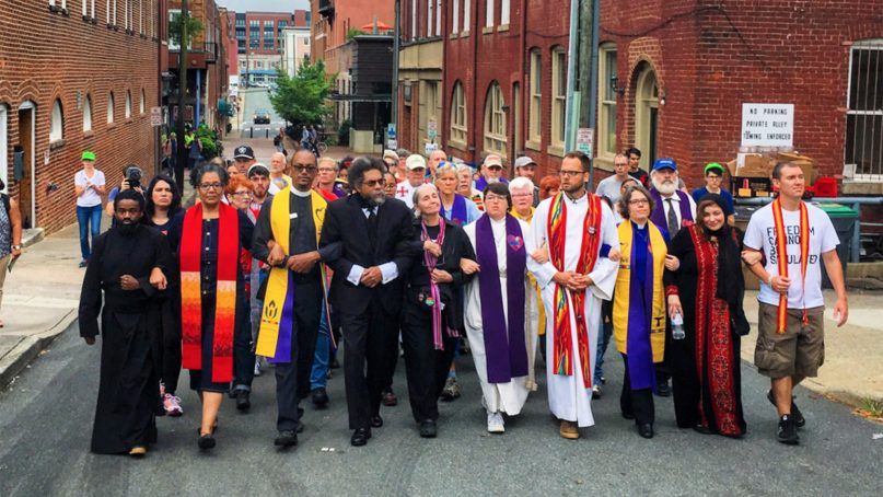 DO NOT USE AGAIN! Clergy and faith leaders march to counter protest the Unite the Right rally in Charlottesville, Virginia, on Aug. 12, 2017. The Rev. Brittany Caine-Conley, fifth from right, helped organize the event. Photo by Jordy Yager *Editors: This photo may only be republished with RNS-MULTIRACIAL-COALITIONS, originally transmitted on February 24, 2020.