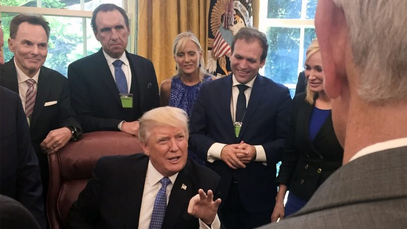 Ronnie Floyd, from left, Rodney Howard-Browne, Adonica Howard-Browne, Johnnie Moore, and Paula White stand behind President Trump as he talks with evangelical leaders on July 10, 2017, in the White House.  Photo courtesy of Johnnie Moore