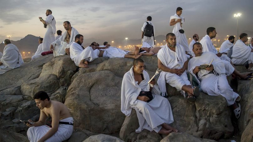 Muslim pilgrims pray on the Jabal Al Rahma holy mountain, or the mountain of forgiveness, at Arafat for the annual hajj pilgrimage outside the holy city of Mecca, Saudi Arabia, on Aug. 20, 2018. More than 2 million Muslims make the annual hajj pilgrimage. The five-day pilgrimage represents one of the five pillars of Islam and is required of all able-bodied Muslims once in their life. (AP Photo/Dar Yasin)