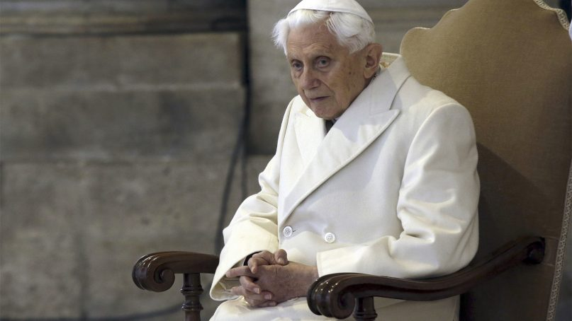Pope Emeritus Benedict XVI sits in St. Peter's Basilica as he attends the ceremony marking the start of the Holy Year on Dec. 8, 2015, at the Vatican. (AP Photo/Gregorio Borgia)