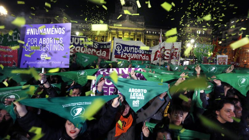 Women stage a demonstration in favor of a measure to expand legal abortions, in Buenos Aires, Argentina, on June 26, 2018. More than 60 percent of Argentinians - especially young people - are in favor of legalizing abortion, according to a poll by the social sciences faculty of the University of Buenos Aires. Argentina's pro-choice movement, which began in 2003, hopes that the Senate will vote in favor of legalizing abortion on Aug. 8, 2018. (AP Photo/Jorge Saenz)