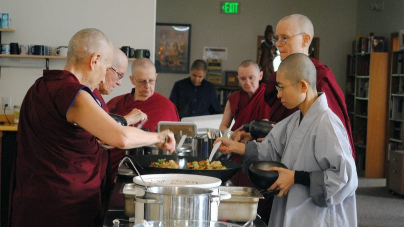 Monastics staying at Sravasti Abbey serve themselves a communally  prepared lunch on Aug. 13, 2018, in Newport, Wash. RNS photo by Tracy Simmons