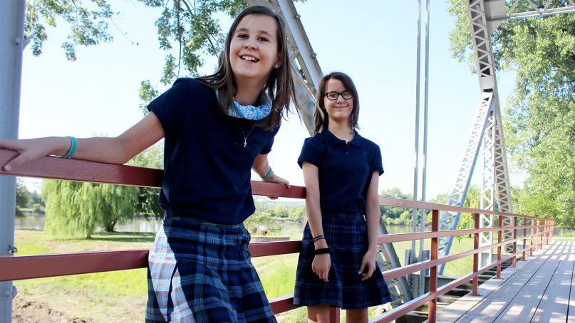 Twins Lauren, left, and Katie Winbinger attend a Catholic school in the Kansas City area. RNS photo by Heather Adams