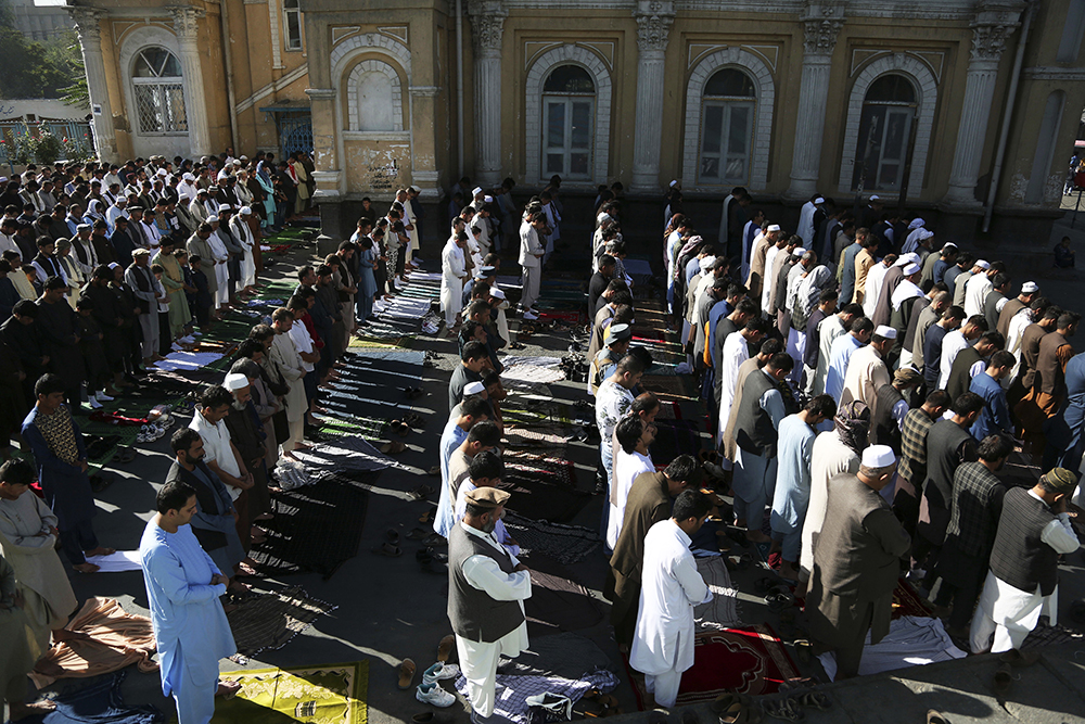 Photo Essay On Eid Aladha Muslims Celebrate Submission To God  Afghan Men Attend Eid Aladha Prayers Outside Of Shahedushamshera Mosque  In Kabul Afghanistan On Aug   During The Eid Aladha