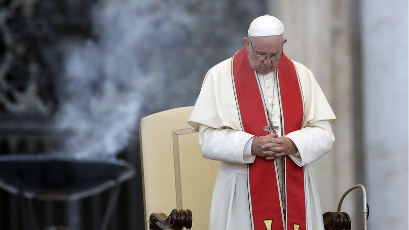 Pope Francis prays during an audience in St. Peter's Square at the Vatican on July 31, 2018.  (AP Photo/Alessandra Tarantino)