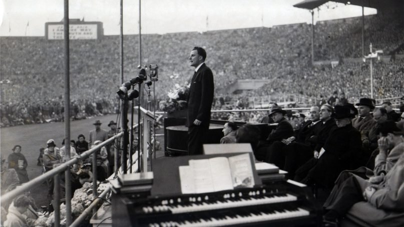 Billy Graham speaks during the closing meeting of the Greater London Crusade at Wembley Stadium on May 22, 1954. RNS file photo