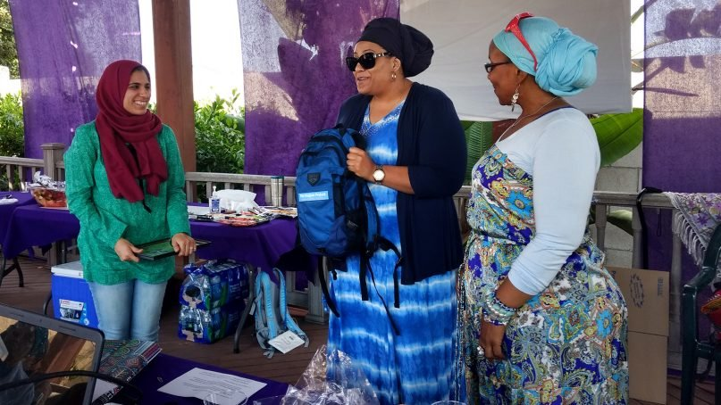 Noor Abbas, center, receives a Hajjah Project backpack on July 15, 2018, in Los Angeles. Photo courtesy Hajjah Project