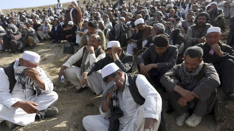 Afghan men cry near the grave of a victim who died during a suicide attack at the Shiite Imam Zaman mosque that was claimed by the Islamic State group, in Kabul, Afghanistan, in October 2017. In a report released Nov. 7, 2017, the U.N. Assistance Mission in Afghanistan said there had been a sharp increase in attacks in Afghanistan targeting places of worship, religious leaders and worshippers, including attacks against Shiite Muslims. (AP Photo/Rahmat Gul)