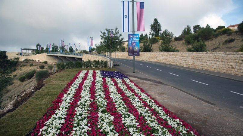 Flowers decorated as an American flag are seen on a road leading to the US Embassy compound ahead of the official opening in Jerusalem on May 13, 2018. The United States moved its embassy in Israel from Tel Aviv to Jerusalem, the holy city at the explosive core of the Israeli-Palestinian conflict and claimed by both sides as a capital. The new embassy came five months after President Donald Trump recognized Jerusalem as Israel's capital. (AP Photo/Ariel Schalit)