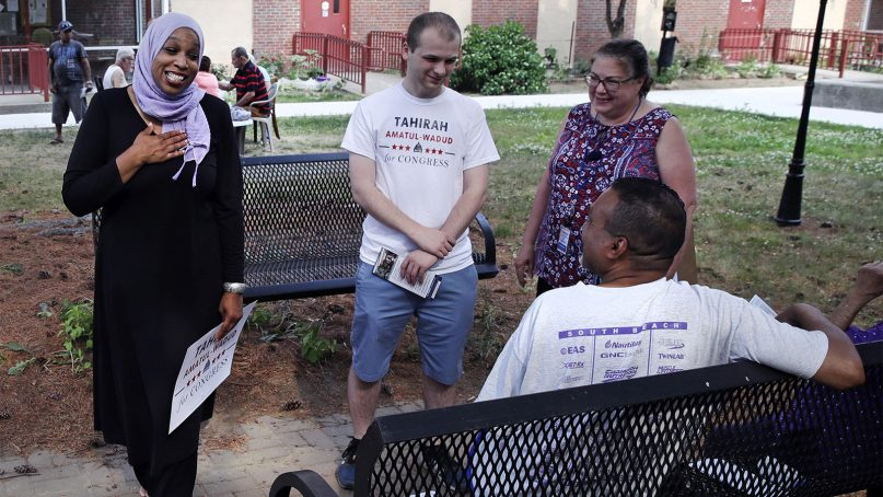 Attorney Tahirah Amatul-Wadud, left, who is challenging incumbent U.S. Rep. Richard Neal, D-Mass., greets residents of an apartment complex while campaigning in Springfield, Mass., on June 18, 2018.  (AP Photo/Charles Krupa)