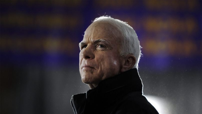 Sen. John McCain waits as he is introduced to speak at a rally in Cedar Falls, Iowa, on Oct. 26, 2008. McCain died Aug. 25, 2018. (AP Photo/Carolyn Kaster)