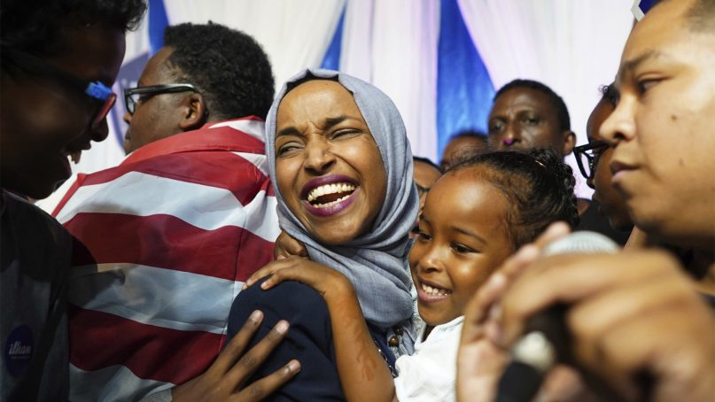 Minnesota state Rep. Ilhan Omar, center, celebrates after her congressional 5th District primary victory on Aug. 14, 2018, in Minneapolis. Omar will be the first woman in U.S. Congress to wear a hijab.(Mark Vancleave/Star Tribune via AP)