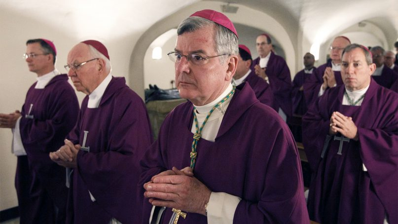 In this March 9, 2012, file photo, Archbishop John C. Nienstedt of St. Paul and Minneapolis, center, and other bishops from Minnesota, North Dakota and South Dakota concelebrate Mass at the Altar of the Tomb in the crypt of St. Peter's Basilica at the Vatican. Photo by Paul Haring/Catholic News Service