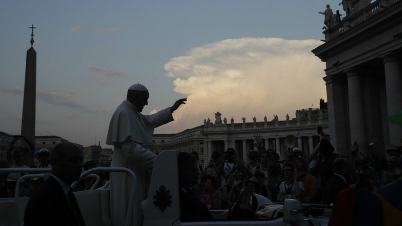 Pope Francis salutes as he leaves after an audience to altar aides in St. Peter's Square at the Vatican on July 31, 2018. (AP Photo/Alessandra Tarantino)