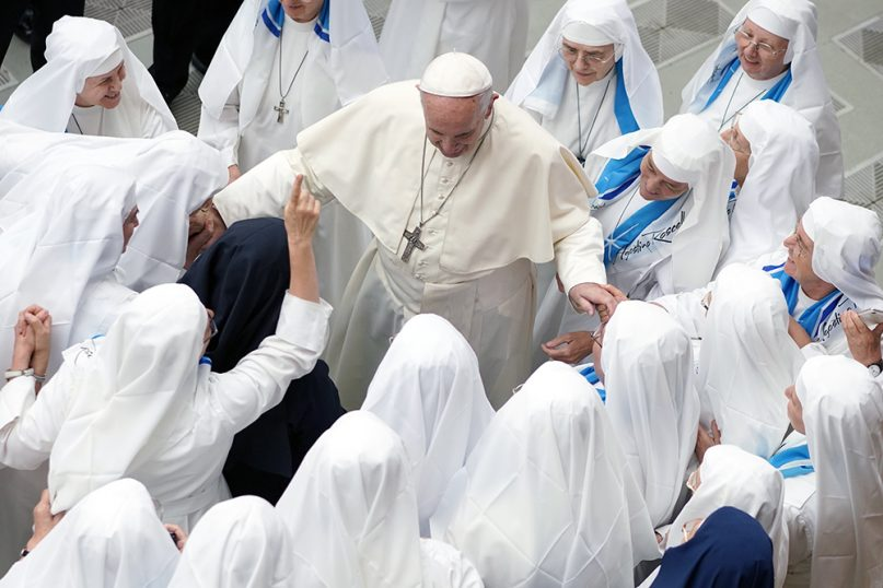 Pope Francis is greeted by a group of nuns during his weekly general audience in the Pope Paul VI Hall at the Vatican, on Aug. 22, 2018. (AP Photo/Andrew Medichini)
