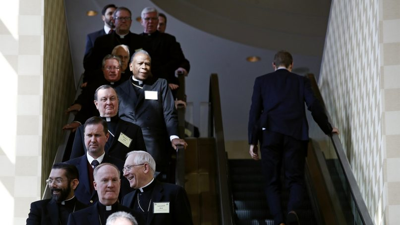 Members of the the U.S. Conference of Catholic Bishops ride an escalator during a break in sessions at the USCCB's annual fall meeting in Baltimore, on Nov. 13, 2017. (AP Photo/Patrick Semansky)