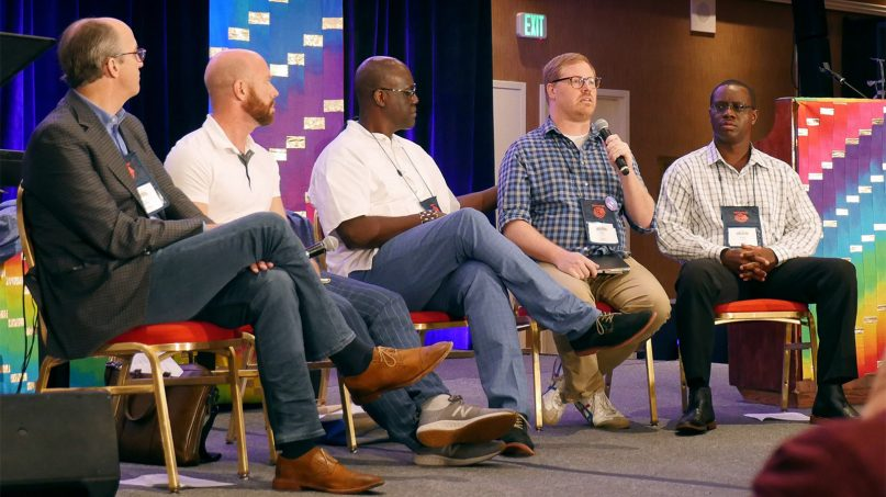 The Rev. Brian Atkins, second from right, speaks about the plans on offer from the Commission on a Way Forward during the For Everyone Born gathering in St. Louis in late July. Photo by Heather Hahn/UMNS