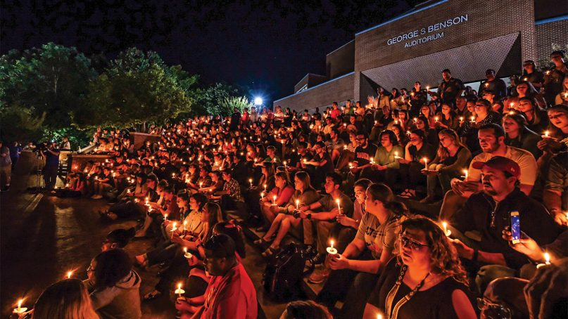 Students, faculty and staff at Harding University in Searcy, Ark., gather Sept. 10, 2018, on the university's Benson Auditorium steps to grieve and remember alumnus Botham Shem Jean. Photo by Noah Darnell, courtesy of Harding University