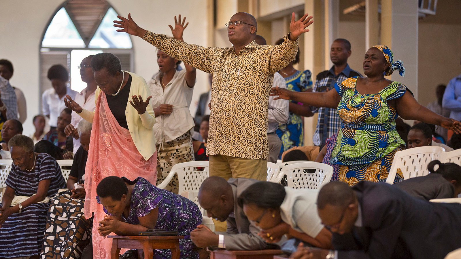 Banned from meeting in church, Rwandan worshippers gather at