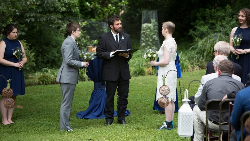 Pastor Isaac Villegas, of Chapel Hill (N.C.) Mennonite Fellowship, officiates the wedding of Kate Dembinski and Kate Flynn on May 21, 2016. Photo courtesy of Dan Scheirer