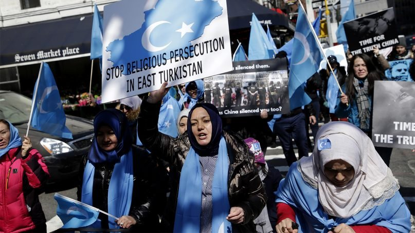 Uighurs and their supporters march to the United Nations to protest in New York, on March 15, 2018. Members of the Uighur Muslim ethnic group held demonstrations in cities around the world to protest a sweeping Chinese surveillance and security campaign that has sent thousands of their people into detention and political indoctrination centers. (AP Photo/Seth Wenig)
