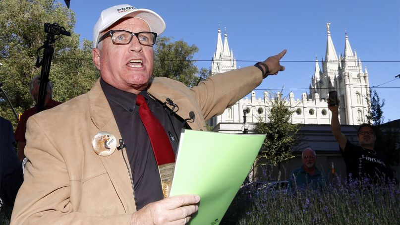 Sam Young speaks during a press conference in Salt Lake City on Sept. 16, 2018. Young, a Mormon man who led a campaign criticizing the church's practice of allowing closed-door, one-on-one interviews of youth by lay leaders has been kicked out of the faith. Young read a verdict letter for the first time Sunday that had been delivered to him following an earlier disciplinary hearing with local church leaders in Houston. Young, a 65-year-old lifelong Mormon, becomes the third high-profile member of the faith who led protests about church policy to be excommunicated in recent years. (AP Photo/Rick Bowmer)