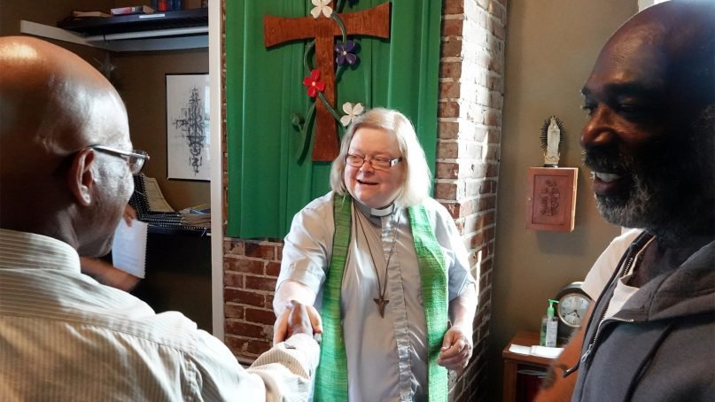 Mother Gillian Klee celebrates Mass with a small group of guests at Constance Abbey, a refuge for the homeless in Memphis. RNS photo by Karen Pulfer Focht