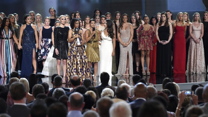 Host Danica Patrick appears with the winners of the Arthur Ashe Award for Courage, at the ESPY Awards at the Microsoft Theater on July 18, 2018, in Los Angeles. More than 140 survivors of sexual abuse by a former team doctor for USA Gymnastics and Michigan State University joined hands on stage to be honored with the award. (Photo by Phil McCarten/Invision/AP)