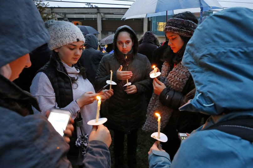Holding candles, a group of girls waits for the start of a memorial vigil at the intersection of Murray Avenue and Forbes Avenue in the Squirrel Hill section of Pittsburgh, for the victims of the shooting at the Tree of Life Synagogue, Oct. 27, 2018. (AP Photo/Gene J. Puskar)