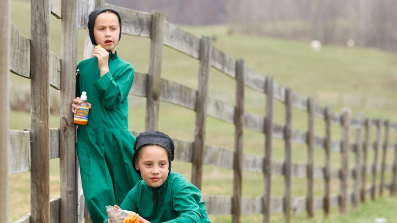 Amish girls eat snacks near the end of the school year in Bergholz, Ohio, on April 9, 2013. (AP Photo/Scott R. Galvin)