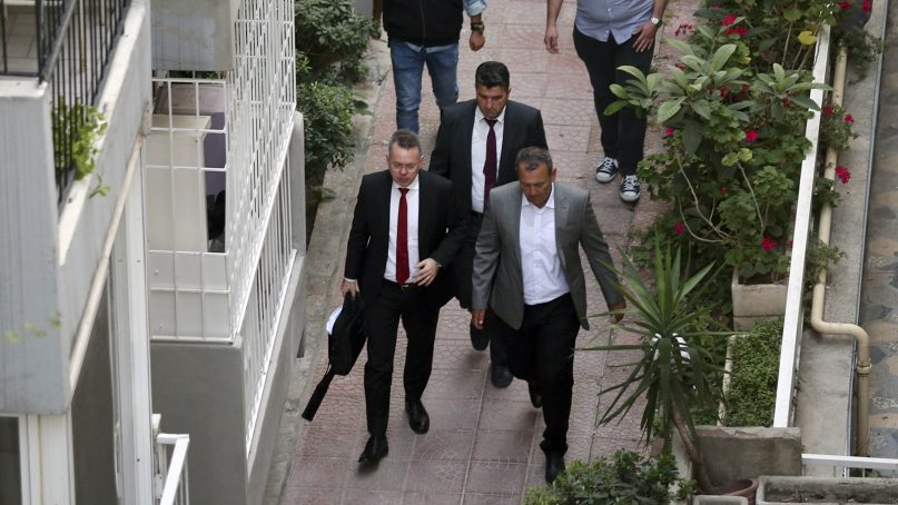 Pastor Andrew Brunson, front left, arrives at home after his release following his trial in Izmir, Turkey, on Oct. 12, 2018. A Turkish court on Friday convicted the American pastor of terror charges but released him from house arrest and allowed him to leave Turkey, in a move that is likely to ease tensions between Turkey and the United States. (AP Photo/Emre Tazegul)