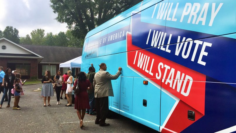 Attendees sign the Values Bus in support of the conservative voter turnout campaign during a tour stop. Both conservative and progressive teams are on bus tours ahead of the midterm elections. Photo courtesy of FRC Action