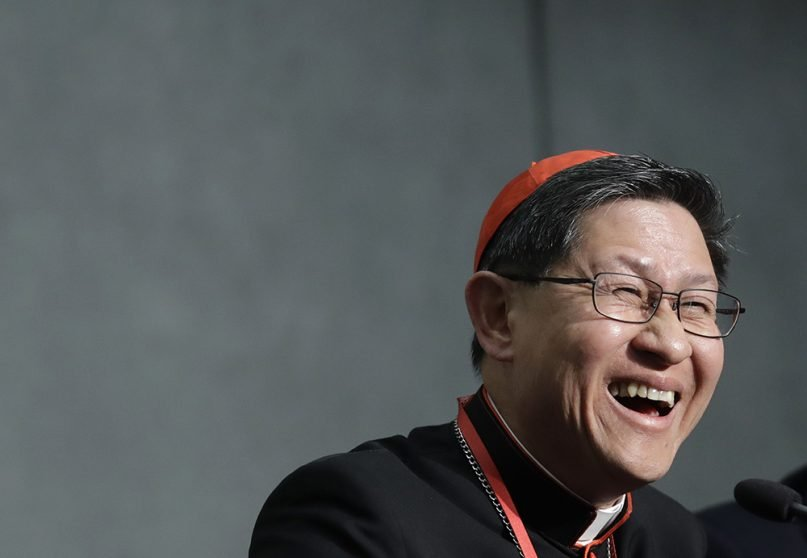 Cardinal Luis Tagle smiles during a news conference on the Synod at the Vatican on Oct. 23, 2018.  (AP Photo/Alessandra Tarantino)