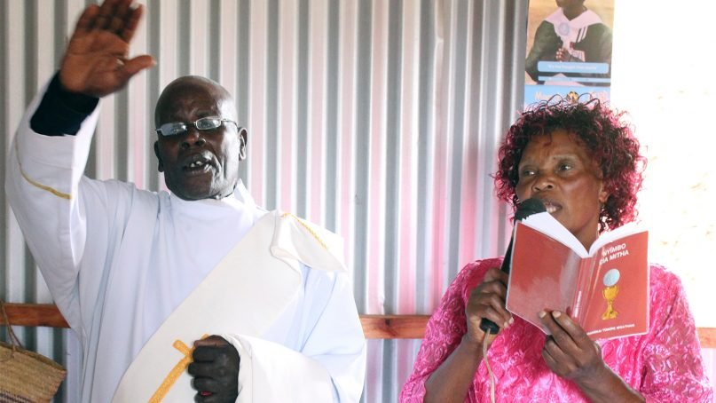 Philip Muiga, left, sings with his wife, Octavia Wangari, before he was ordained as a priest in the Renewed Universal Catholic Church in April 2018, in Nyeri County, Kenya. RNS photo by Doreen Ajiambo