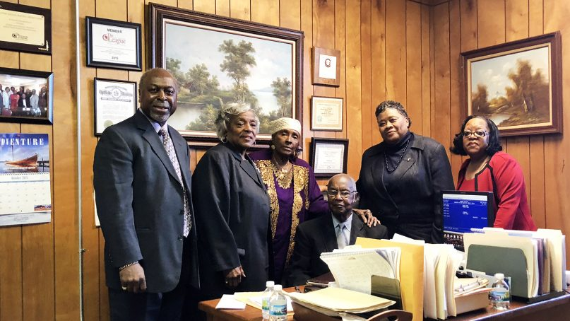 Board members of the Greater Galilee Missionary Baptist Church Credit Union gather in the credit union's office in Milwaukee on Oct. 21, 2018. Board members are Ed Murphy, from left, Jynette Hamilton, Gloria Neff, William Coffer, Ella Dunbar and Vinia Neal. The group runs the credit union on a volunteer basis.RNS photo by Katelyn Ferral