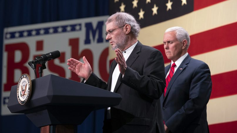 Rabbi Loren Jacobs, left, of Congregation Shema Yisrael, says a prayer during a rally in Michigan with Vice President Mike Pence, on Oct. 29, 2018. (David Guralnick/Detroit News via AP)