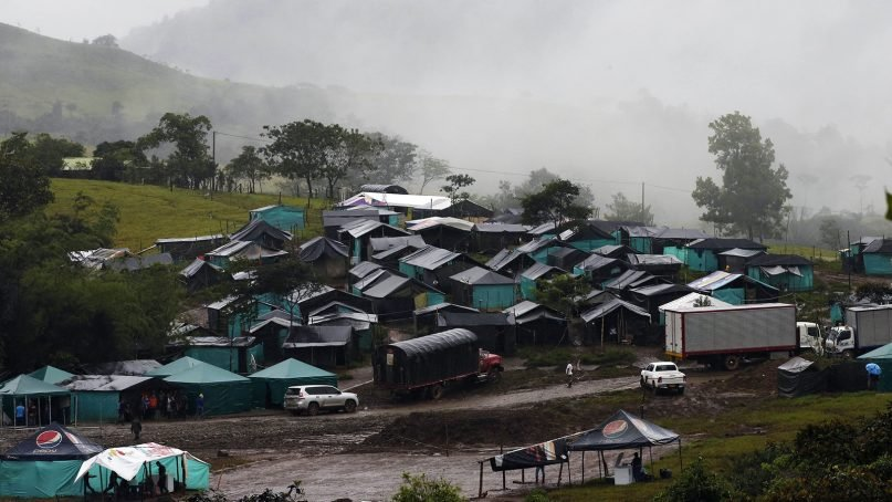 Fog hovers over the Mariana Paez transition zone, one of many rural camps where rebel fighters from the Revolutionary Armed Forces of Colombia, known as FARC, are making their transition to civilian life, near the municipality of Mesetas, Colombia, on June 26, 2017. (AP Photo/Fernando Vergara)