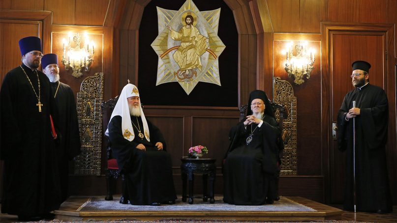 Ecumenical Patriarch Bartholomew I, center right, the spiritual leader of the world's Orthodox Christians, sits with Patriarch Kirill of Moscow, center left, prior to their meeting at the Patriarchate in Istanbul on Aug. 31, 2018. Orthodox Patriarchate's Metropolitan Emmanuel of France says