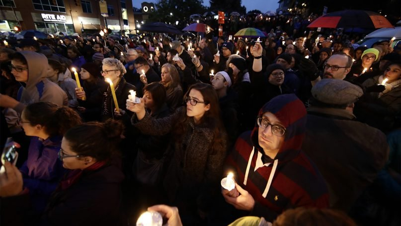 People hold candles as they gather for a vigil in the aftermath of a deadly shooting at the Tree of Life Congregation, in the Squirrel Hill neighborhood of Pittsburgh, on Oct. 27, 2018. (AP Photo/Matt Rourke)