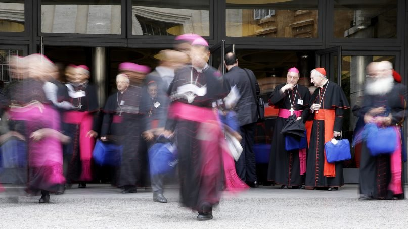 Cardinals and bishops leave the Synod Hall at the end of a morning session of the synod of bishops at the Vatican on Oct. 11, 2018. The meeting of bishops on young people runs from Oct. 3-28. (AP Photo/Alessandra Tarantino)